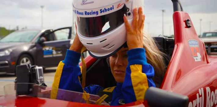 Girl in race car with helmet