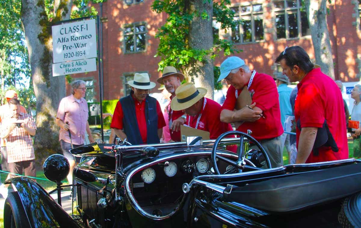 People gather around this vintage automobile