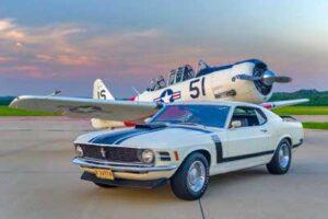 plane and car in hangar