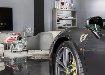 The Car Collection Suites Living Rom and Garage