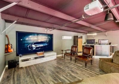 Interior view of a Island Storage Suites Car Condo TV Media Room with Custom Bar