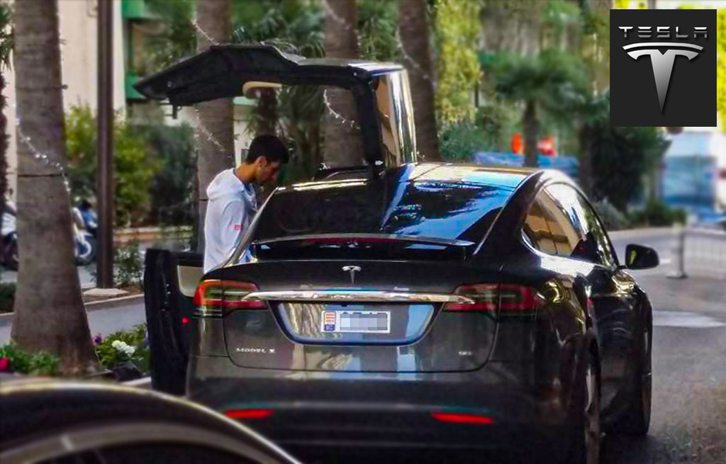 Novak Djokovic getting in a Model X Tesla